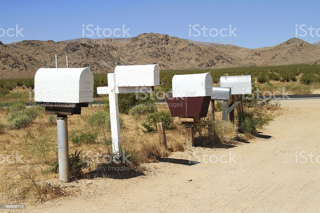 Row of mailboxes on a rural dirt road royalty-free stock photo