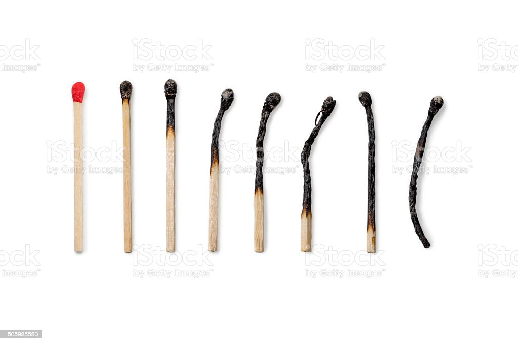 Row of Matches new to burned stock photo