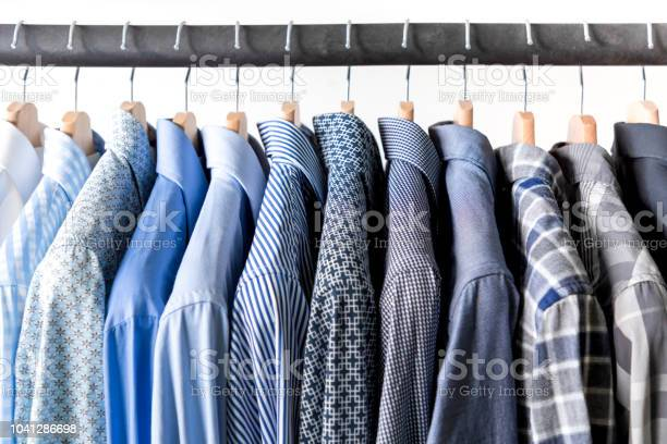 Row of mens shirts in blue colors on hanger picture id1041286698?b=1&k=6&m=1041286698&s=612x612&h=ex3p3uyes67nudrckowxms9bcczrtsyt92evo67klni=