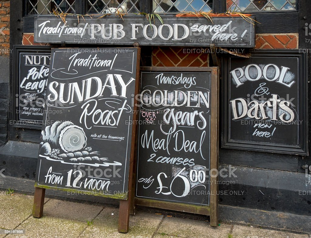 Row of menu boards outside a pub stock photo