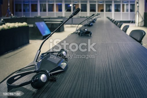 609903512 istock photo A row of microphone and headphone sets 1052897132