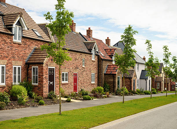 Row of Modern Houses Modern brick houses, built to traditional designs on a housing development in Northern England. northeastern england stock pictures, royalty-free photos & images