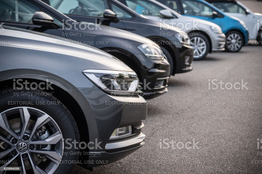A row of modern vehicles standing on a public parking space in Hamburg, Germany stock photo