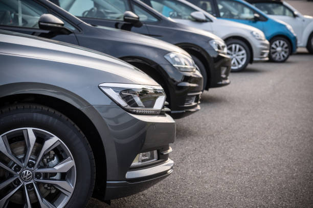 a row of modern vehicles standing on a public parking space in hamburg, germany - used car selling stock pictures, royalty-free photos & images