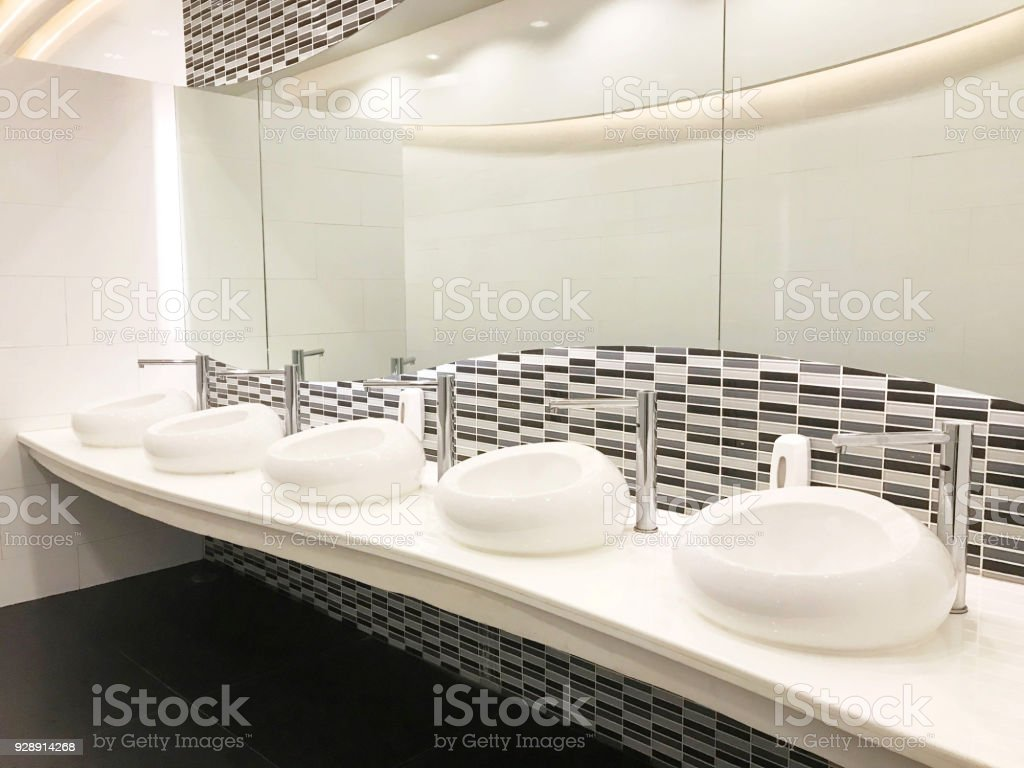 Row Of Modern White Ceramic Wash Basin In Public Restroom Or ...