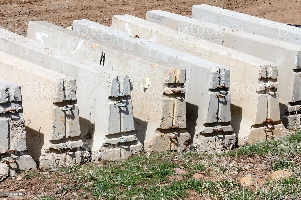 Row of modular F-shaped concrete barriers in a row stock photo