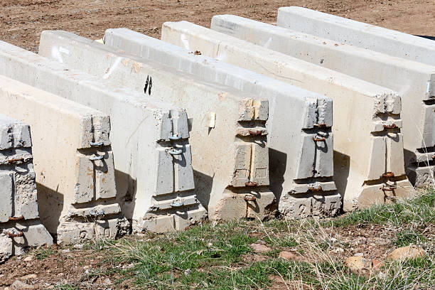 Row of modular F-shaped concrete barriers in a row