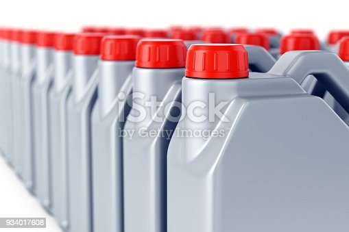istock Row of motor oil jerry cans 934017608