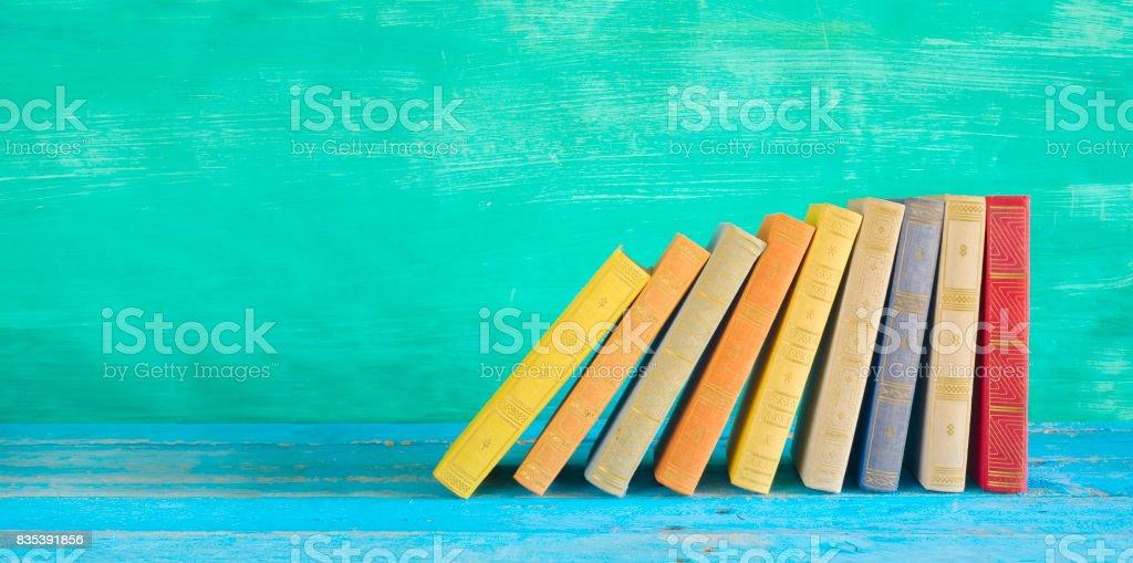row of multicolored books stock photo