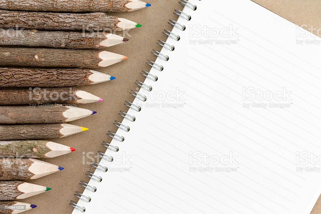 Row of natural wood colored pencil crayons stock photo