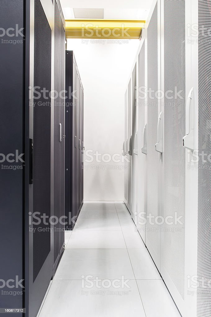 Row of network servers in datacenter room royalty-free stock photo