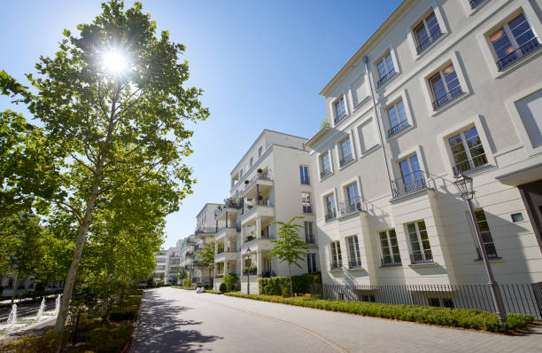 Row of new apartment houses and trees stock photo