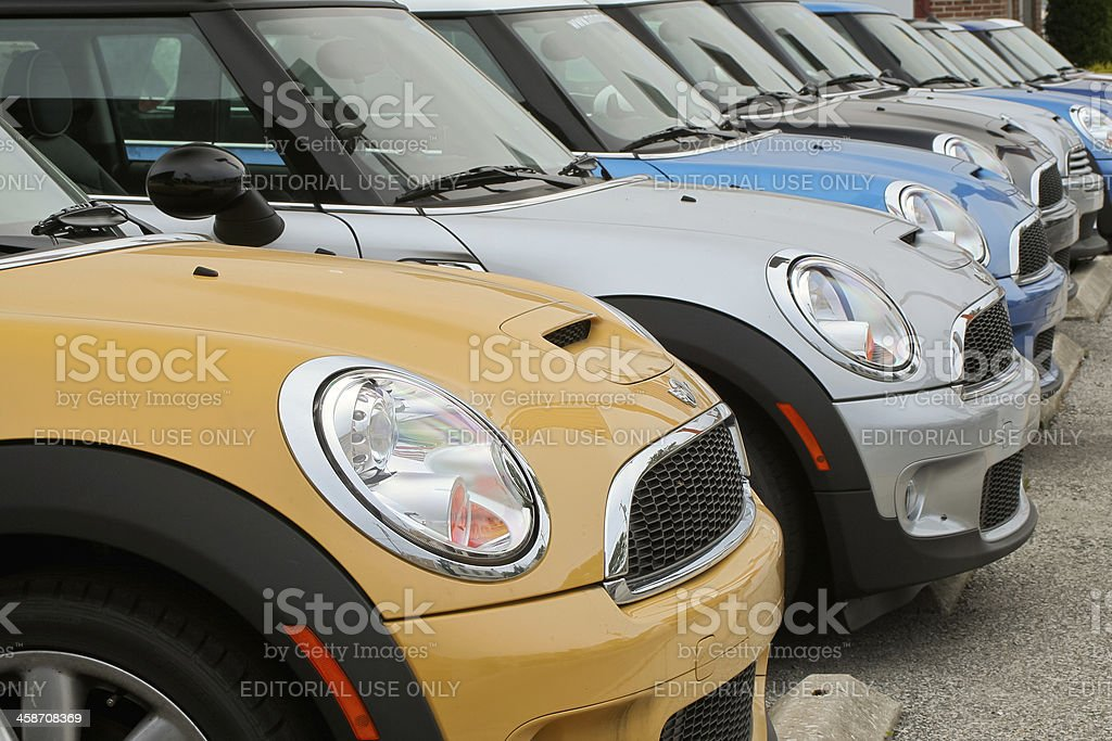 Row of new BMW Mini Cooper cars at dealership stock photo