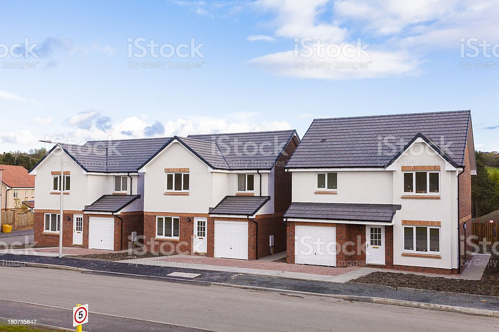 Row of new detached houses. A row of newly built detached houses. Architecture Stock Photo