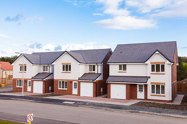 Row of new detached houses. stock photo