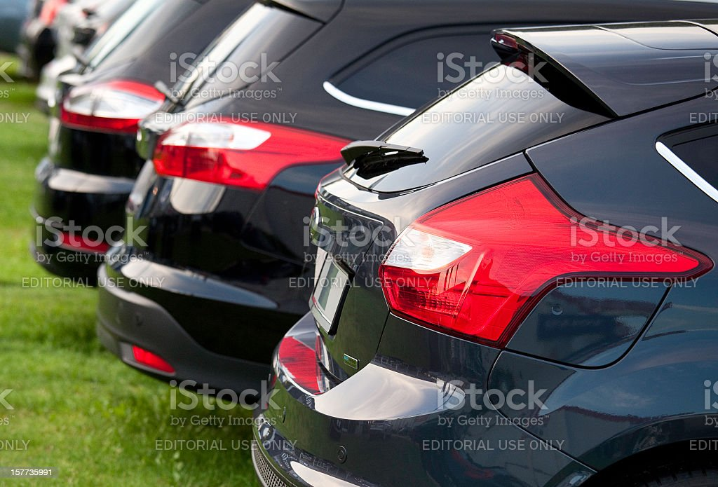Row of new Ford Focus vehicles at dealership stock photo