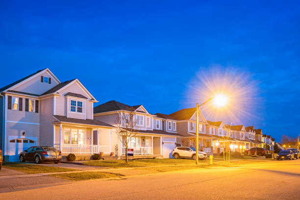 row of new homes in brantford ontario canada - suburban street stock photos and pictures