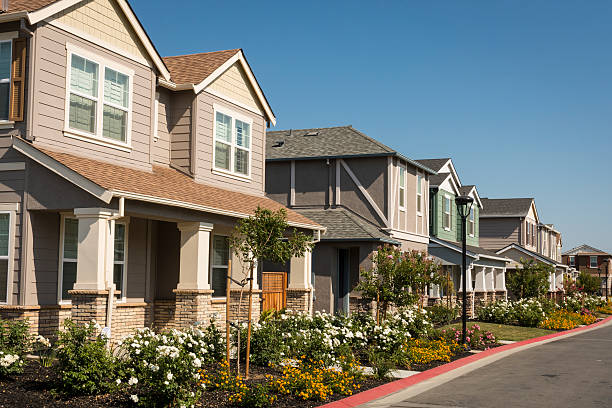 Row of New Houses A row of newly-built houses in a residential subdivision. detached house stock pictures, royalty-free photos & images