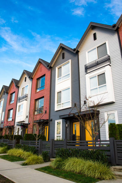 A row of new real estate townhouses or condominiums. stock photo
