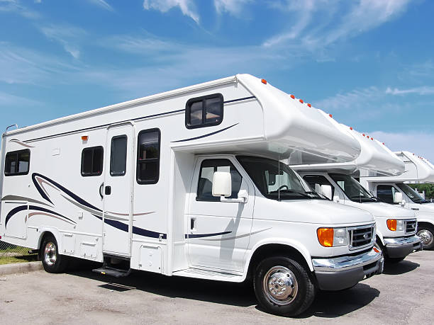 row of new recreational vehicles - motorhome stock photos and pictures