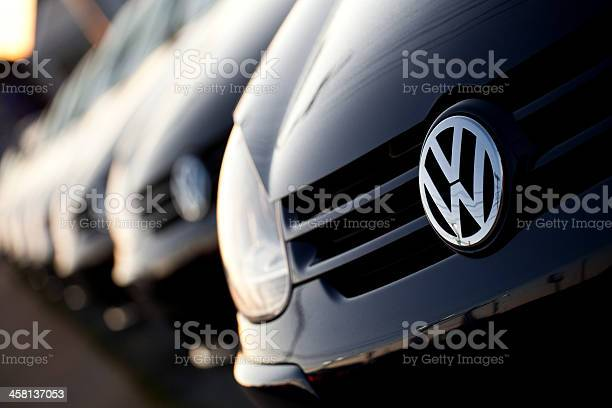 """Halifax, Nova Scotia, Canada - July 24, 2011: Closeup view of a row of new Volkswagens at the Volkswagen dealership on kempt road. Volkswagen is a large German automobile manufacturer that originated in 1937."""