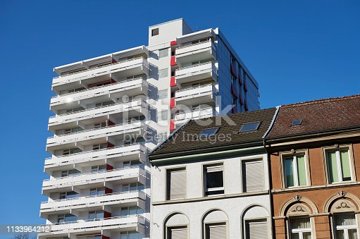 Row of old townhouses and 1970´s highrise building, Neuss, Germany.