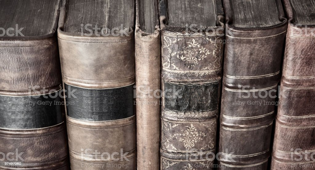 Row of old leather bound books royalty-free stock photo