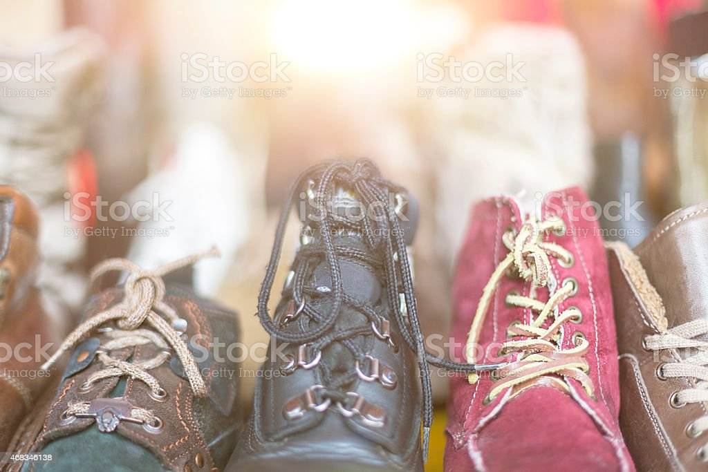 row of old shoes on a flea market stock photo