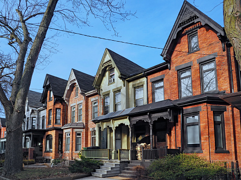 Row of old Victorian style brick houses with gables