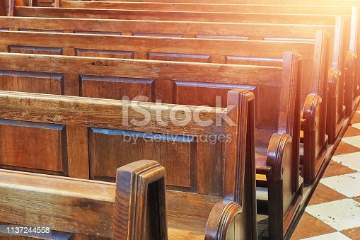 istock row of old wooden chair benches inside church 1137244558
