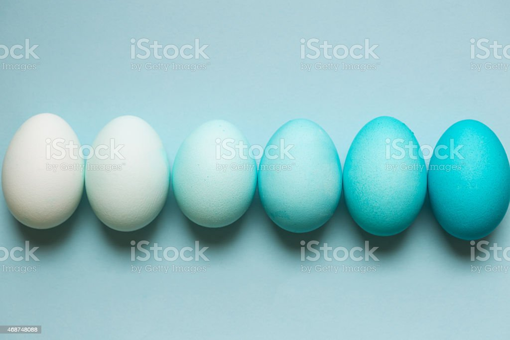 Row of ombre Easter eggs stock photo