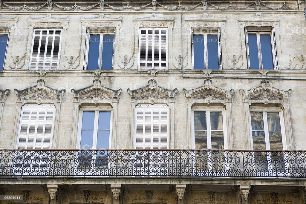 Row of open and shuttered windows in Bordeaux, France royalty-free stock photo