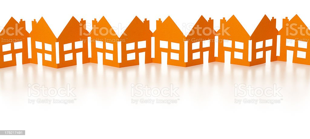 Row of orange paper chain houses royalty-free stock photo