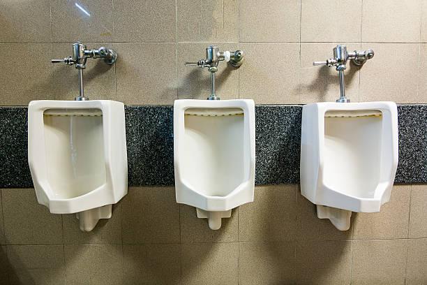 row of outdoor urinals men public toilet - badezimmer new york style stock-fotos und bilder