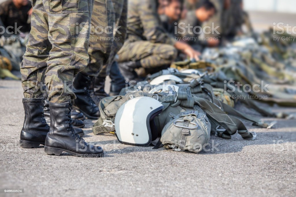 row of paratrooper in camouflage uniform standby with t-10 parachute helmet and equipment with copy space stock photo