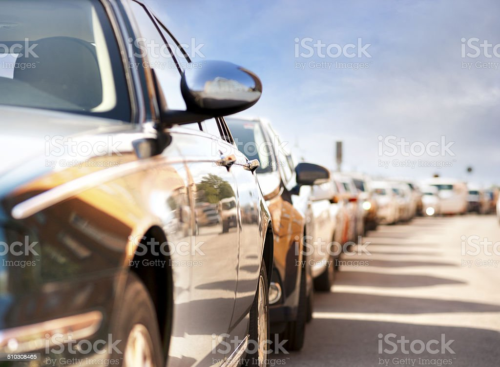 Row of parked cars stock photo