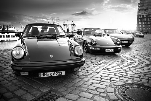 A row of parked Porsche 911 vehicles during the event with Magnus Walker on the Fish Market Hamburg