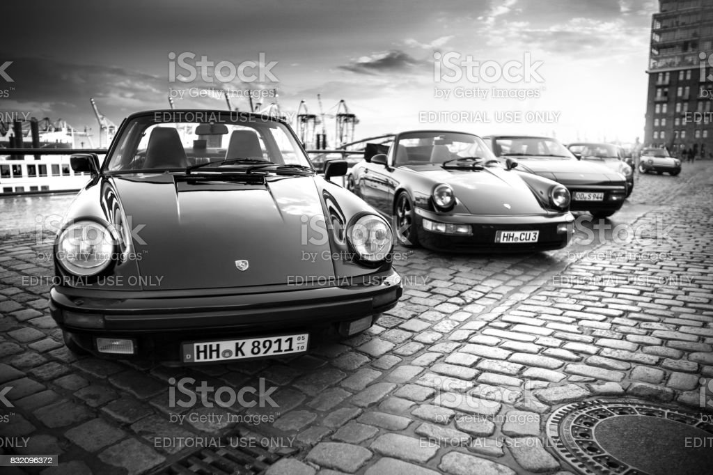 A row of parked Porsche 911 vehicles during the event with Magnus Walker on the Fish Market Hamburg stock photo