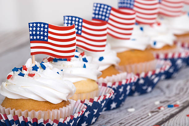 Row of patriotic cupcakes with sprinkles and American flags stock photo