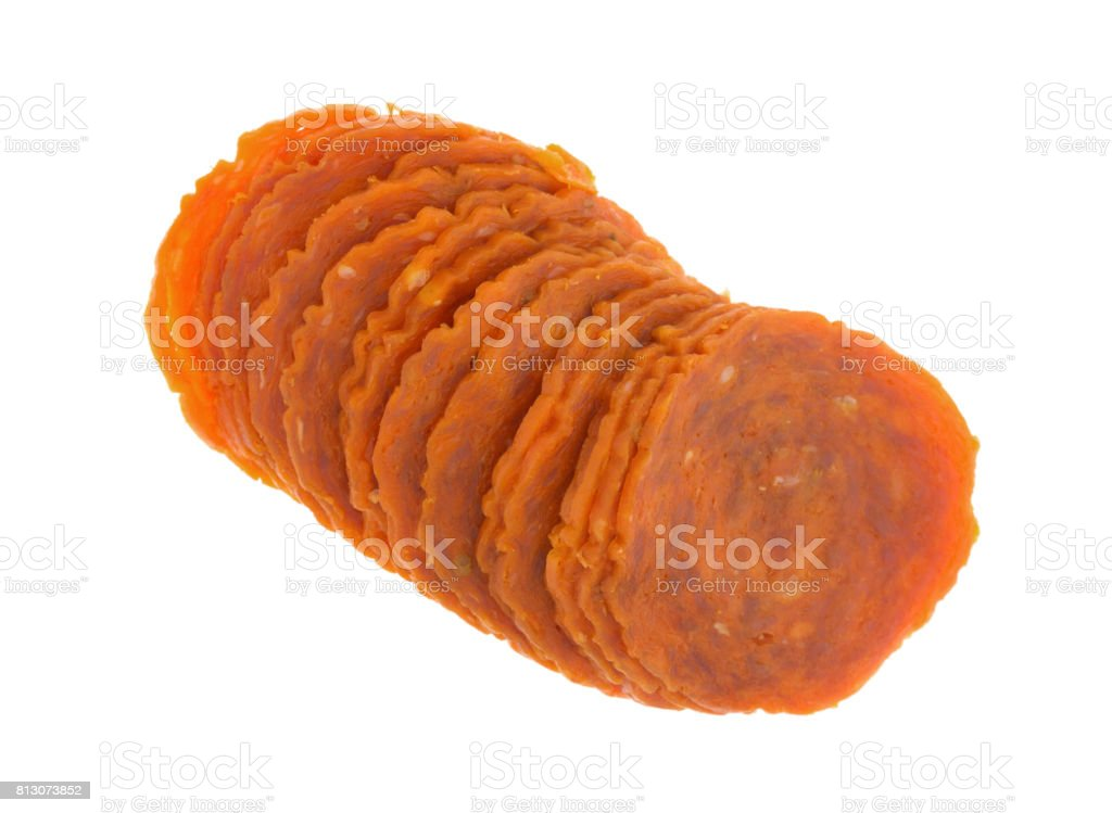 Row of pepperoni slices on a white background stock photo