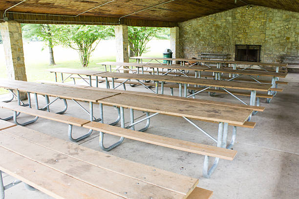 Row of picnic tables in a shelter house stock photo