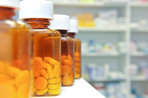 A Row Of Pill Bottles On A Pharmacy Counter Stock Photo - Download Image Now