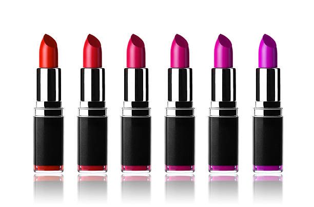 Row of pink and purple lipsticks stock photo