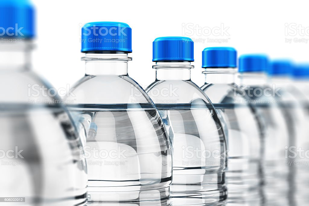 Row of plastic drink water bottles stock photo