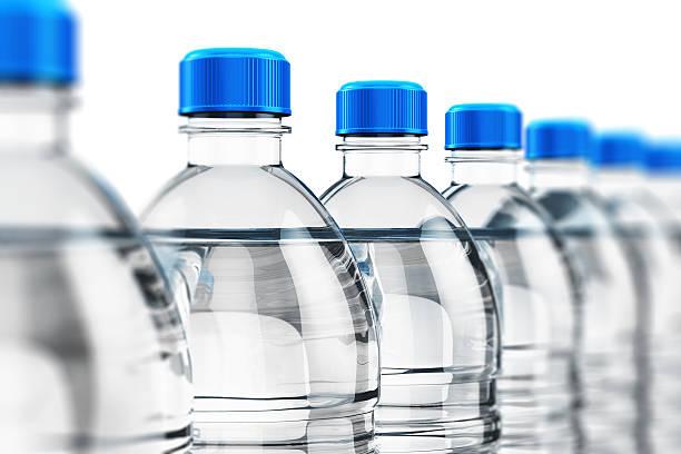 Row of plastic drink water bottles stock photo