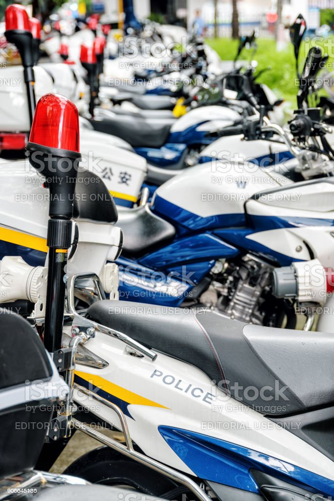 Row of police motorcycles parked along a street, Shenzhen, China stock photo