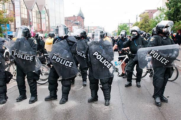 Row of Police Officers  riot police stock pictures, royalty-free photos & images