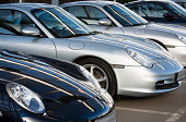 Ulm, Germany - January 13, 2007: A Row of Porsche 911 Carrera, luxury sports coupe cars for sale on display outside of a car dealership. The Porsche is manufactured in Stuttgart, Germany.