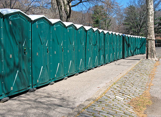 Row of portable toilets stock photo