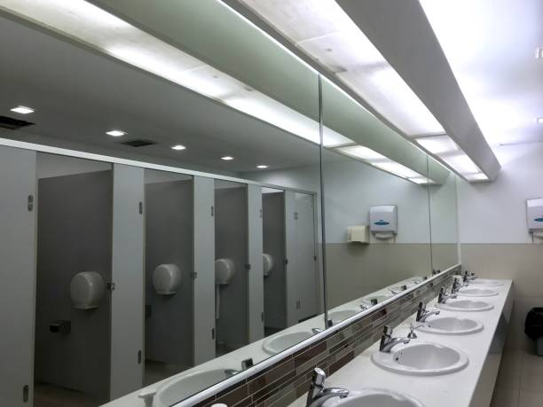 Row of public toilet decorated with wooden partition stock photo